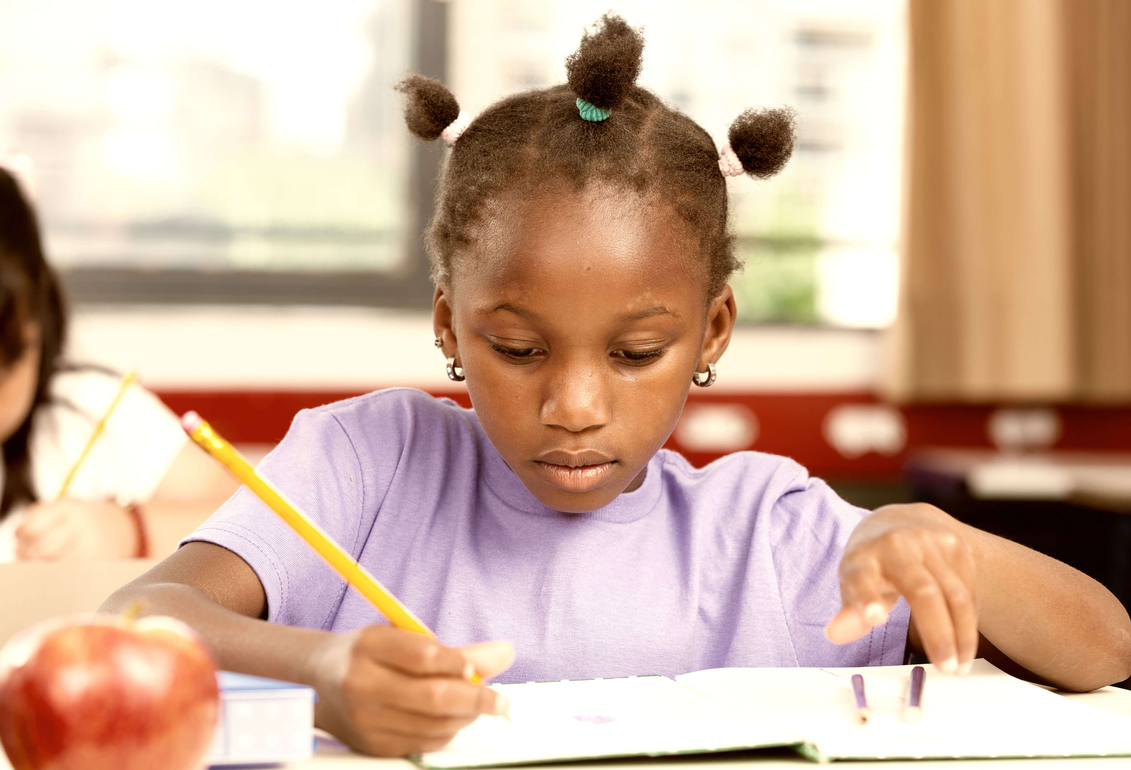Girl doing homework at Education Tutoring Services